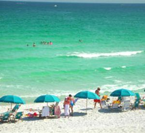Beach chairs and umbrellas available at Inlet Reef Club Condominiums in Destin Florida