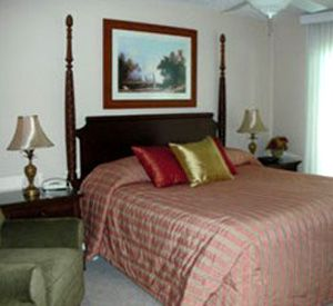 A bedroom at Inlet Reef Club Condominiums in Destin Florida
