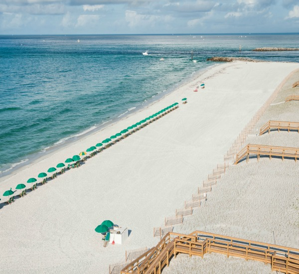 West aerial view of beach in front of Jetty East in Destin Florida