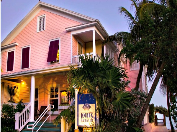 pink-painted exterior of Louie's Backyard restaurant in Key West - Louie's Backyard In Key West Florida