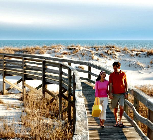 Couple on beach walkway at Martinique on the Gulf in Gulf Shores Alabama