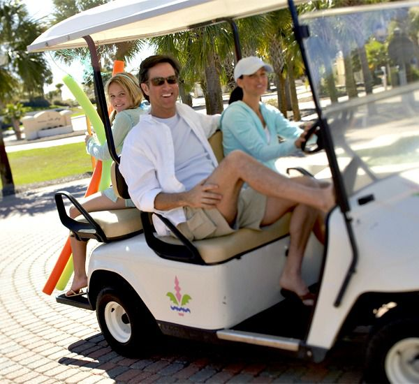 Family riding in a golf cart at Martinique on the Gulf in Gulf Shores Alabama