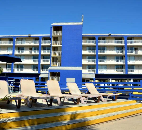 Deck chairs facing pool at Ocean Breeze Hotel in Panama City Beach FL