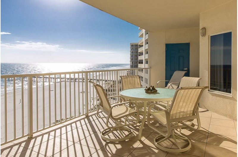 Gulf-front balcony with table and chairs at Admirals Quarters Orange Beach