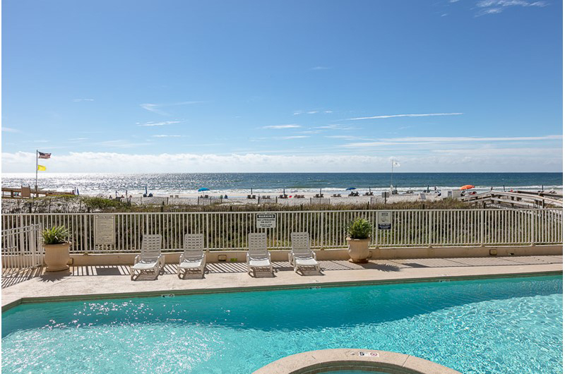 Enjoy the pool with a view of the Gulf at Four Winds in Orange Beach AL