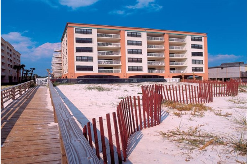 The beach is directly in front of Harbour Place in Orange Beach Alabama