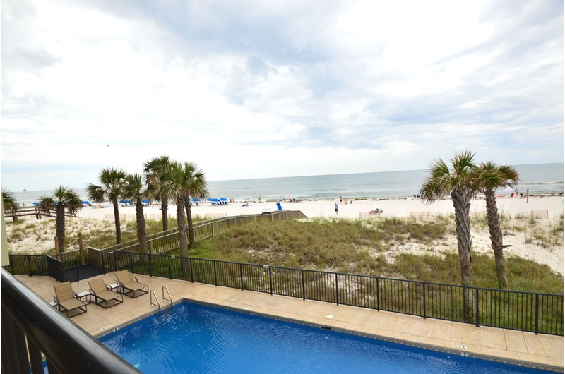 Enjoy a view of the pool and beach from Perdido Quay in Orange Beach Alabama