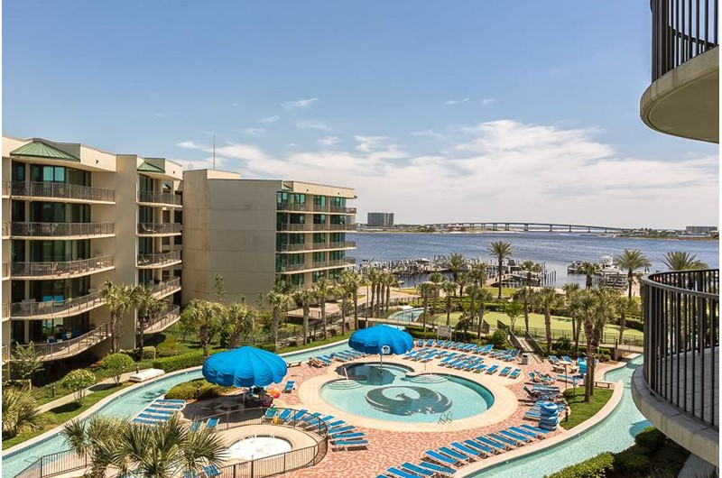 Look out your door and see the amazing pool area and water at Phoenix on the Bay in Orange Beach AL