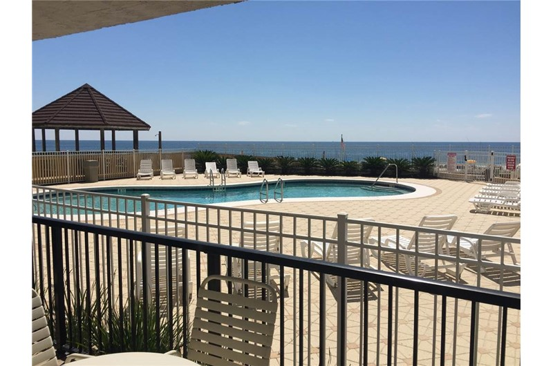 View of pool from patio area at Romar Tower in Orange Beach AL