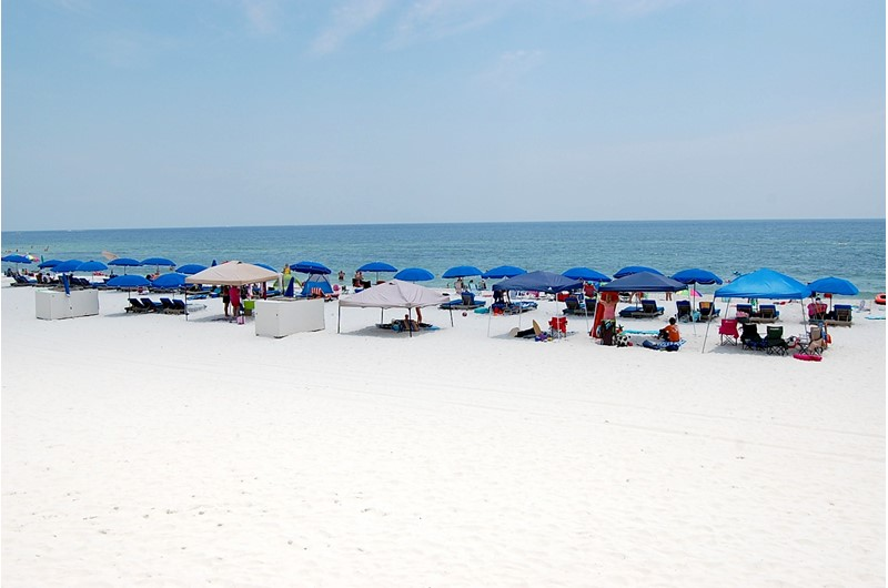 Large beach area in front of Seaside Beach and Racquet in Orange Beach AL
