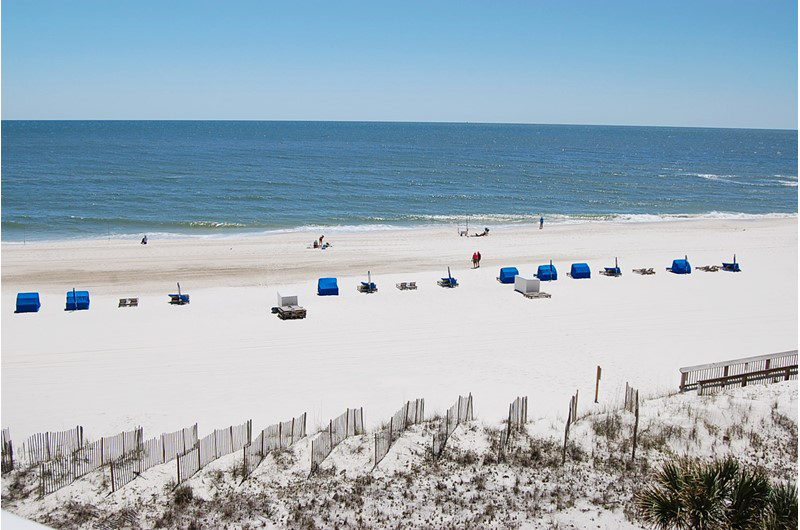 Spend you day reading and book on the balcony and people watching on the beach at Seaside Beach and Racquet Club in Orange Beach Alabama