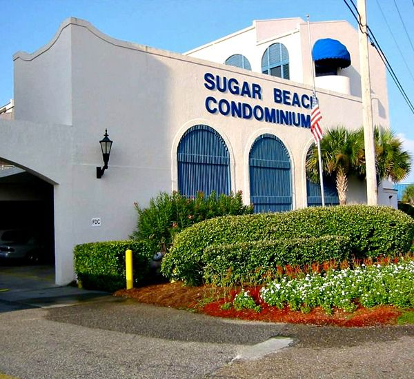 Exterior and lush landscaping at Sugar Beach in Orange Beach AL