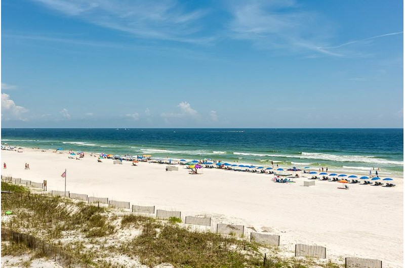 Take a stroll down the beach in front of The Enclave in Orange Beach AL
