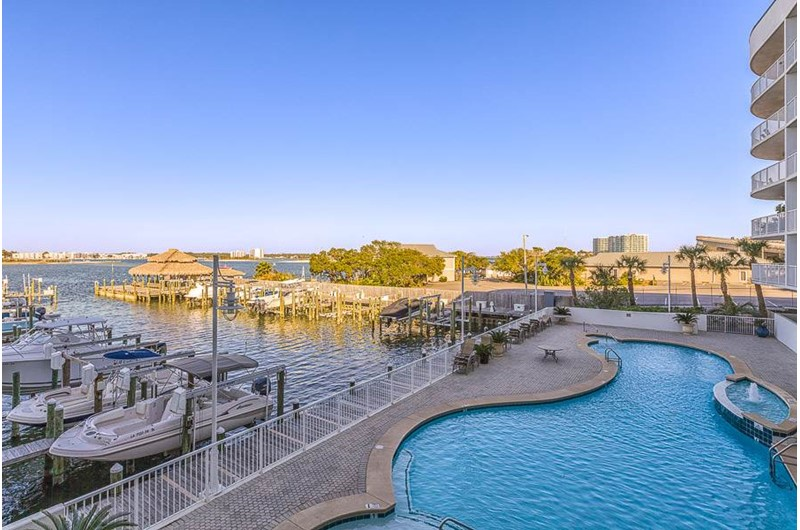 View of pool and water from The Pass in Orange Beach Alabama