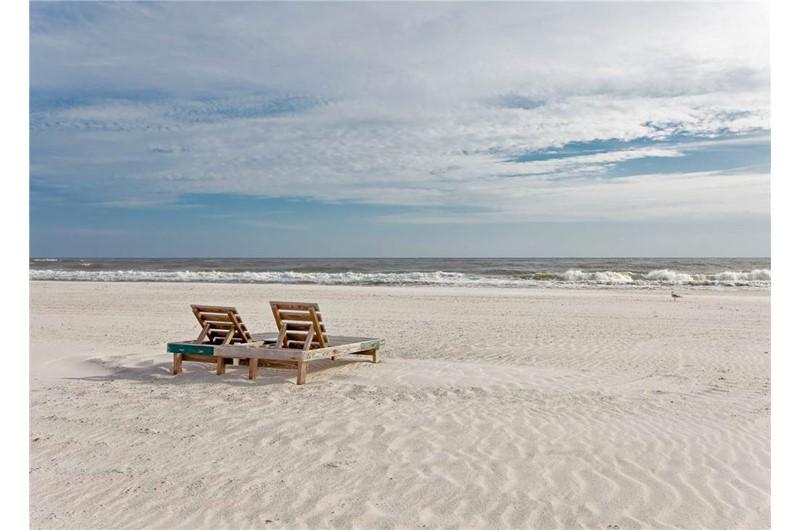 Pristine white sandy beach in front of Tidewater in Orange Beach Alabama