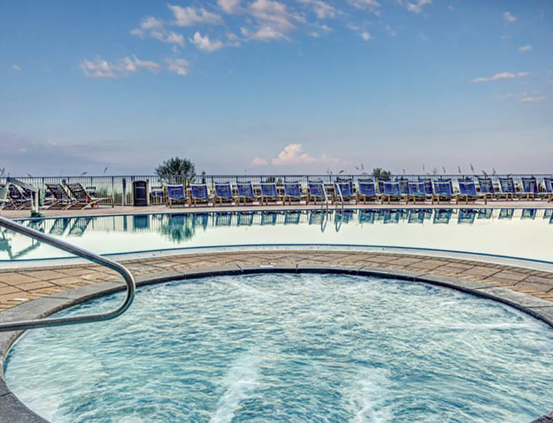 Let your worries melt away in the large hot tub at Emerald Beach Resort in Panama City Beach FL