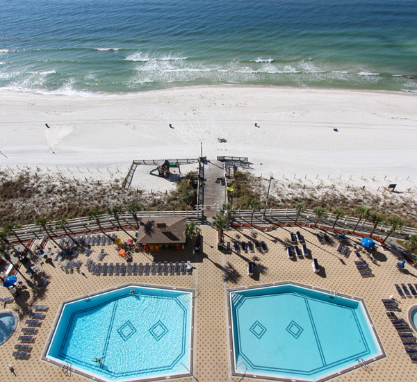 Aerial view of the beachfront pools at En Soleil Panama City Beach Florida