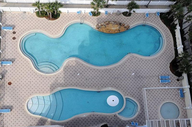 Birds eye view of the pool area at Majestic Beach Resort in Panama City Beach FL