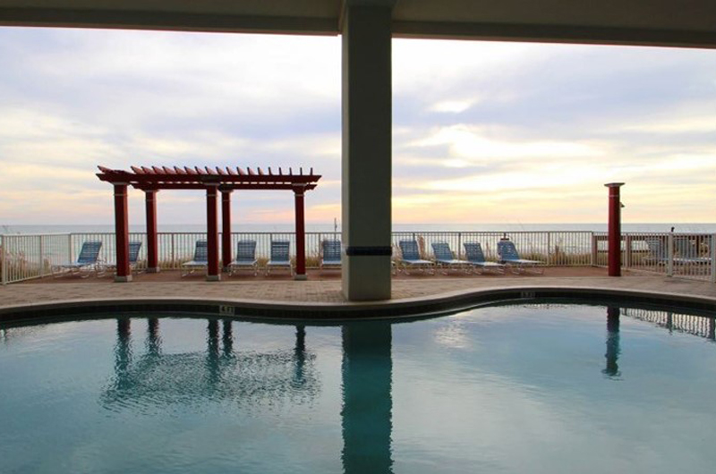 Take a dip at sunset in the outdoor pool at Majestic Beach Resort in Panama City Beach FL