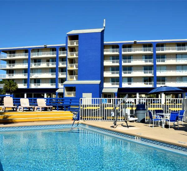 Exterior view of balconies facing pool at Ocean Breeze Hotel in Panama City Beach FL