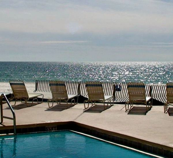 Gulf-front pool and lounge chairs at Pelican Walk Panama City