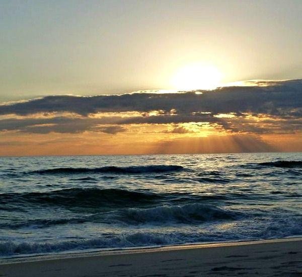 Cloudy Gulf sunset at Pelican Walk Panama City