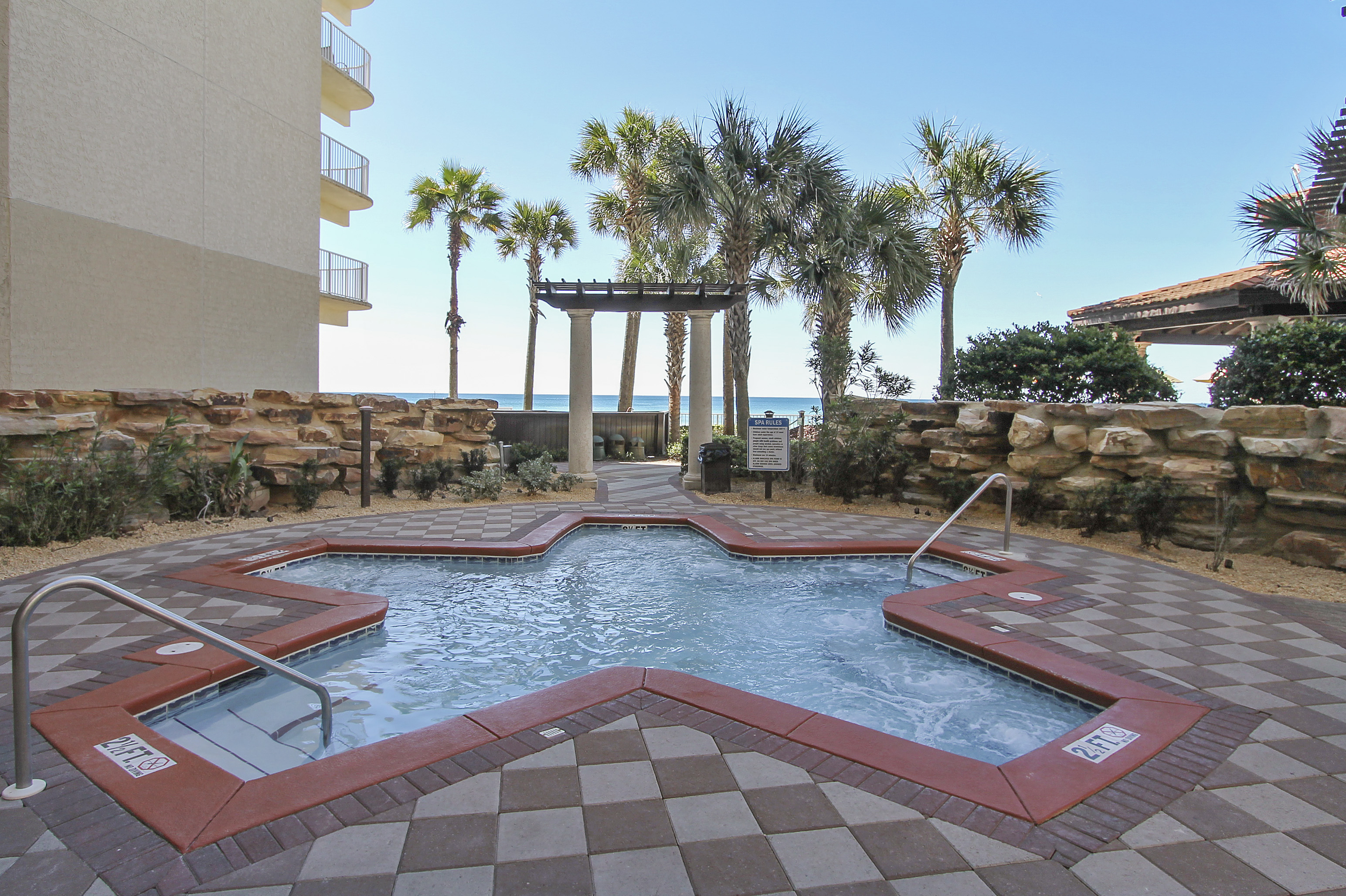 Melt your cares away in the hot tub at Shores of Panama Panama City Beach FL