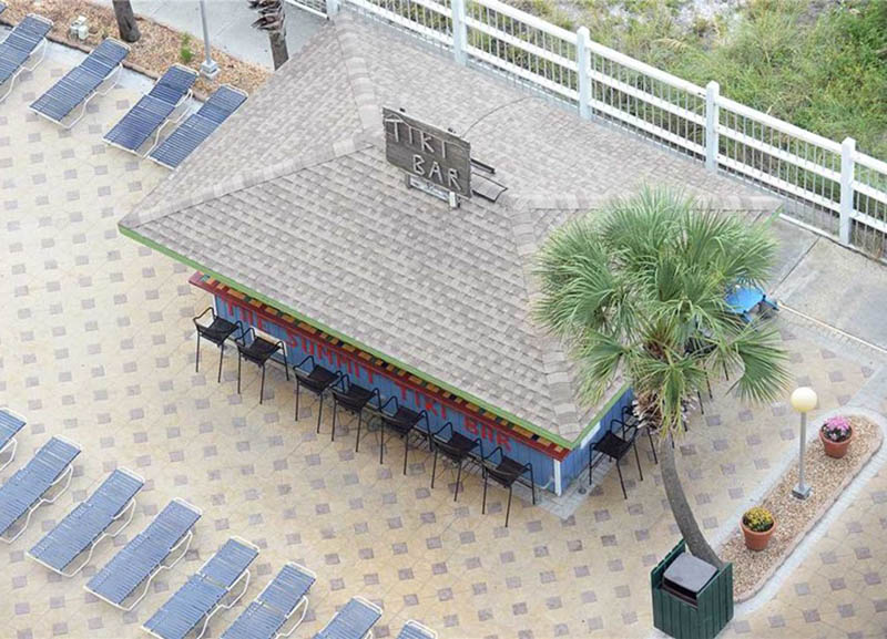 Enjoy a cool drink from the on-site tiki bar at Summit Beach Resort in Panama City Beach Florida