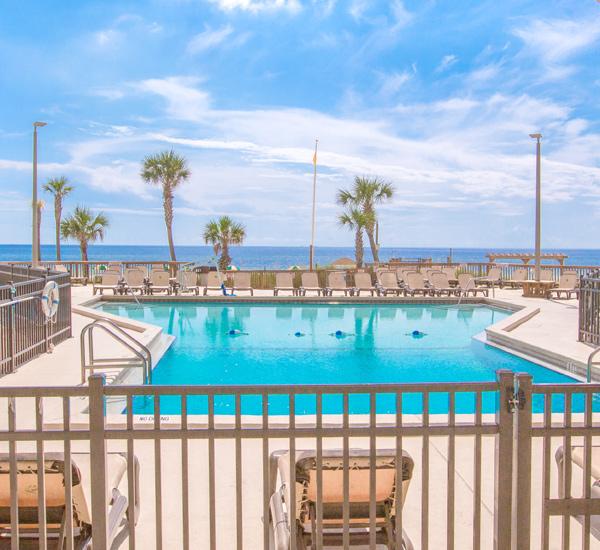 Enjoy a view of the pool and beach at Sunbird Beach Resort in Panama City Beach Florida