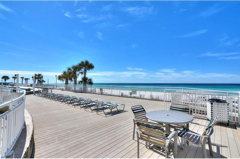 Relax on the pool deck that overlooks the Gulf at Watercrest Condominiums in Panama City Beach Florida