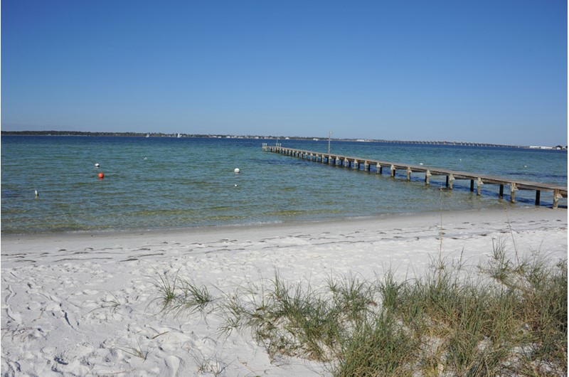 Enjoy the sand between your toes on the bay at Baywatch Condos in Pensacola Beach FL
