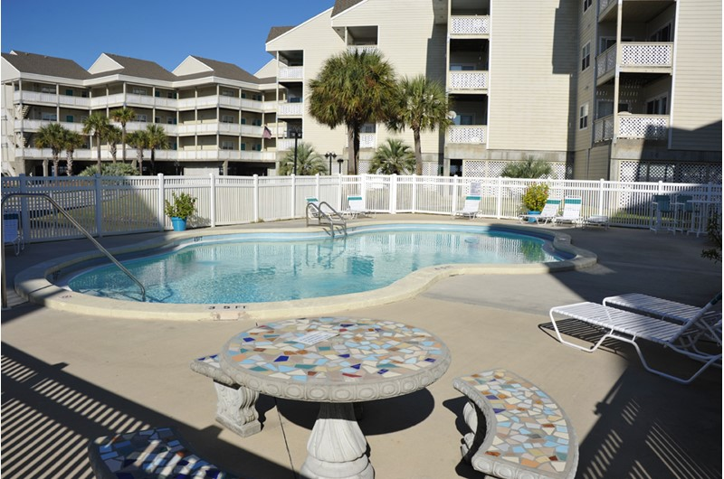 Relax by the pool at Baywatch Condos in Pensacola Beach Florida