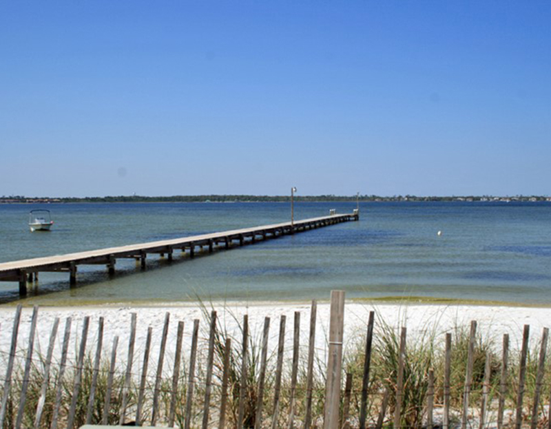 Take a walk in the sand on the bay at Baywatch Condos in Pensacola Beach Florida
