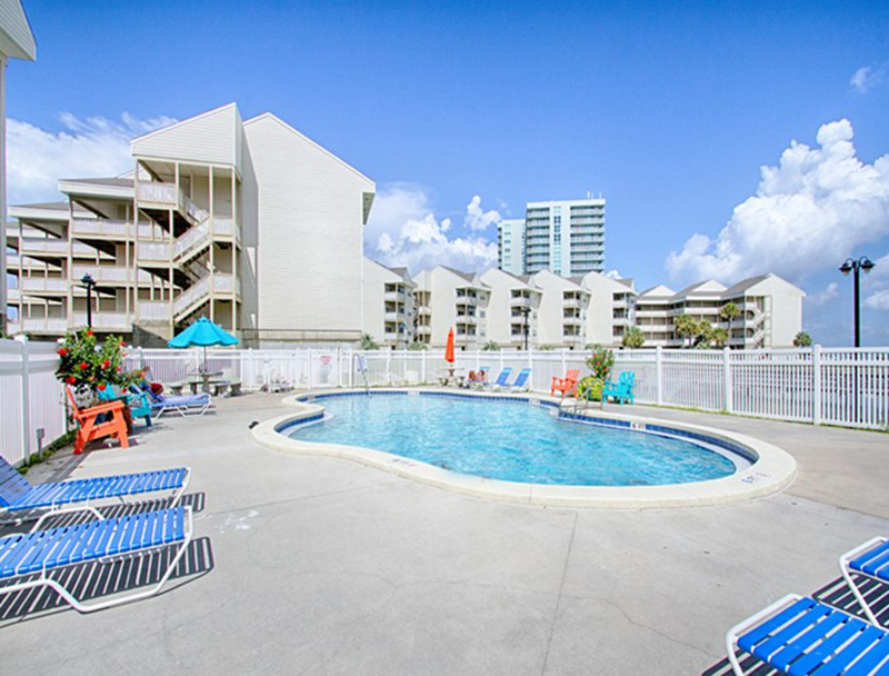 Take a dip in the pool at Baywatch Condos in Pensacola Beach Florida