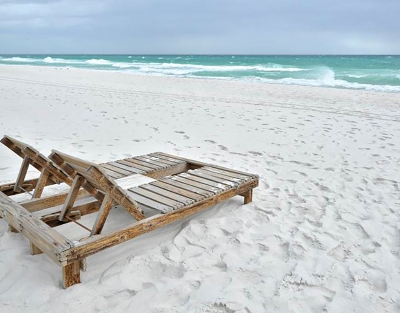 The white sandy beach is steps from Emerald Isle in Pensacola Beach Florida