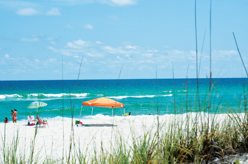 The Gulf of Mexico and white sandy beaches are steps from Gulf Winds in Pensacola Beach FL
