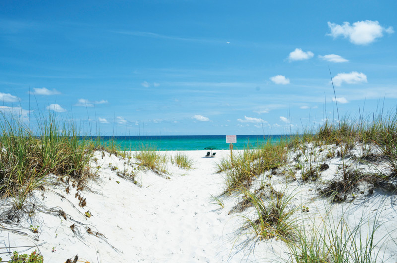 Gorgeous white sandy beach in front of Gulf Winds in Pensacola Beach FL