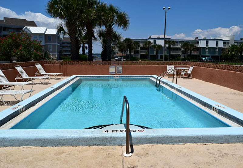 Enjoy the lovely pool area at Gulf Winds in Pensacola Beach FL