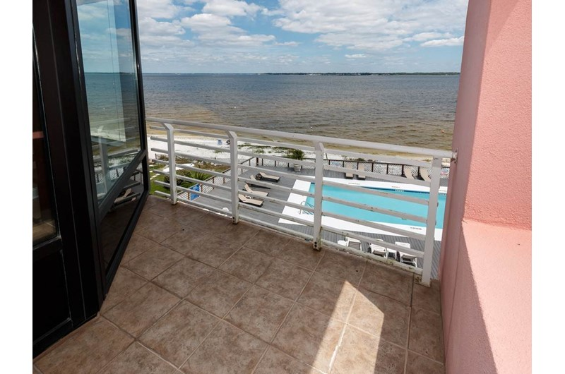 Set on your balcony and view the pool and beach at Palm Beach Club Pensacola FL