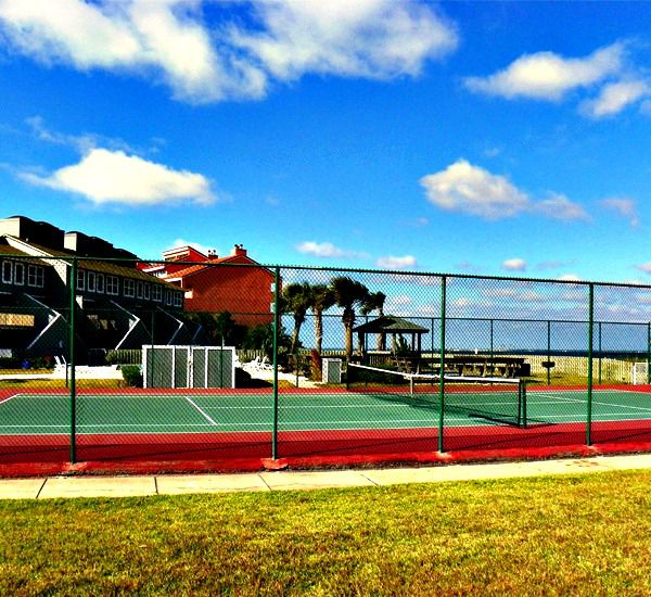 Play a round of tennis at San DeLuna Townhomes in Pensacola Beach Florida