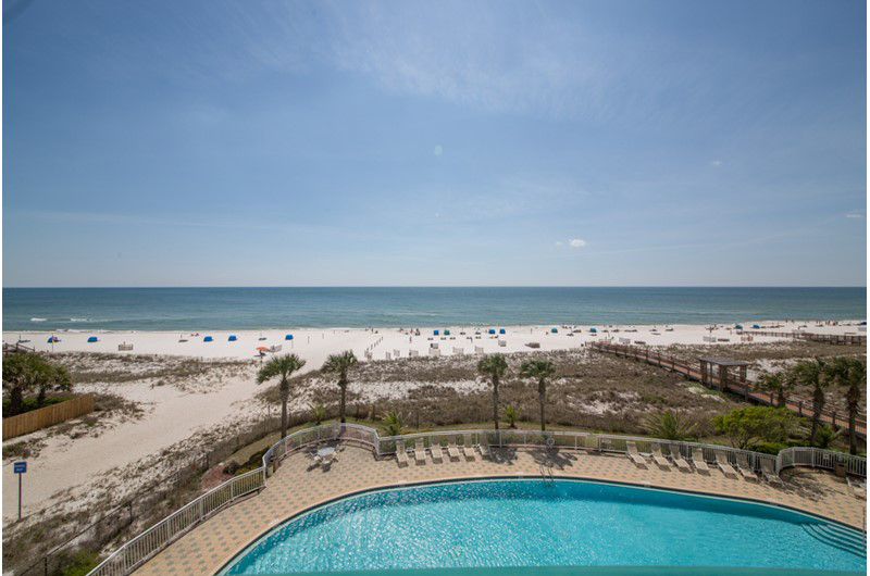 Take in the salty air while swimming in the gorgeous pool at Beach Colony in Perdido Key FL