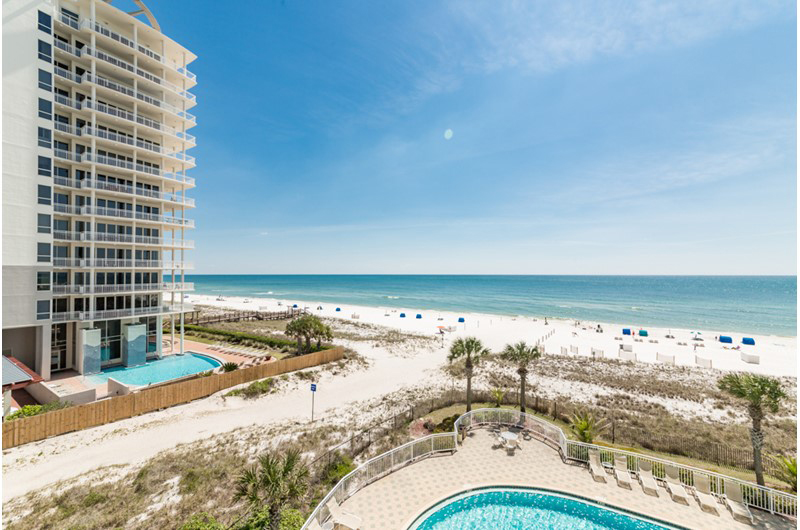 Take in the view of both the pool and the beach at Beach Colony in Perdido Key FL