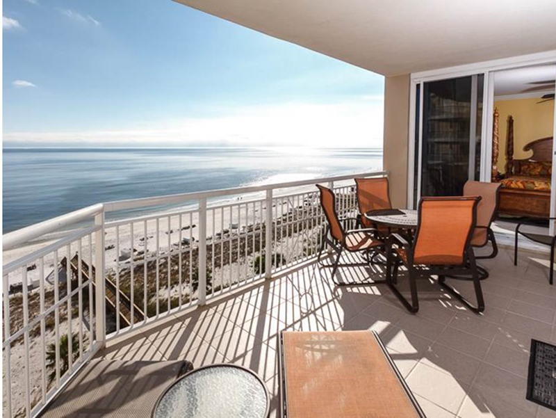 Relax with a book and take in the salty air from your balcony at  Indigo Condo in Perdido Key Florida