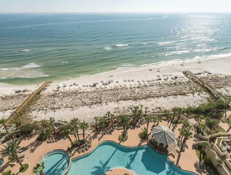 Relax on the balcony and watch the kids in at the pool at  Indigo Condo in Perdido Key Florida
