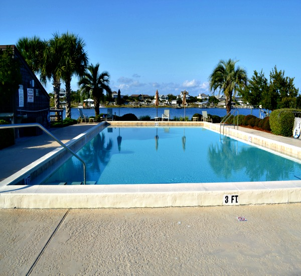 Outdoor pool facing river view at Needle Rush Point in Perdido Key FL