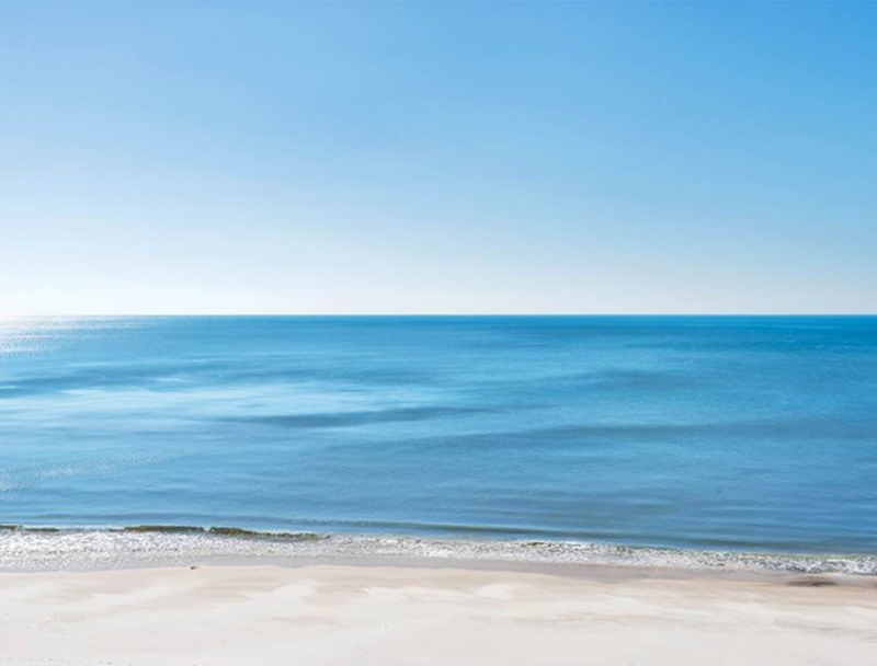 Look out at the crystal blue water of the Gulf from Perdido Sun Condominiums in Perdido Key Florida