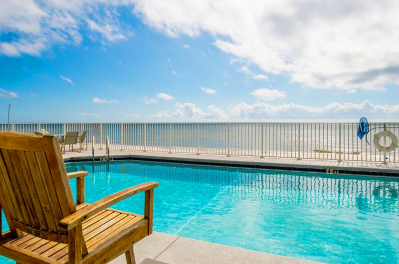 You will relax poolside and watch the waves role in at Windemere Condominiums in Perdido Key Florida