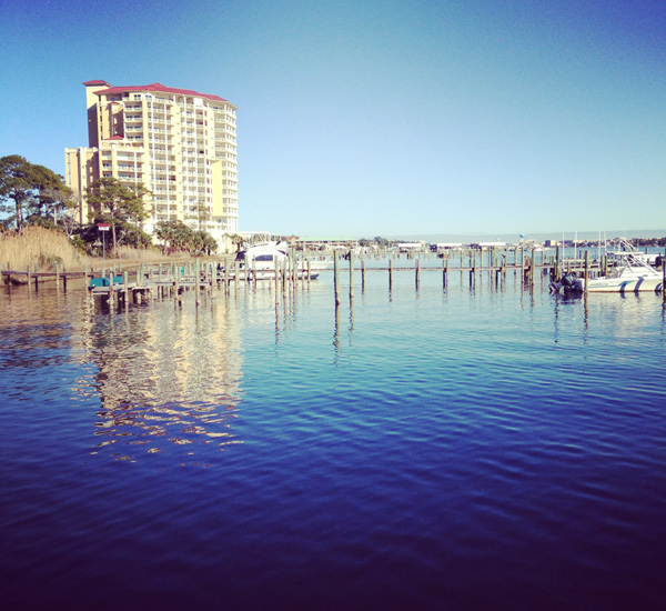 Pirates' Bay Guest Chambers & Marina reflected in the Intercoastal Waterway in Fort Walton Florida