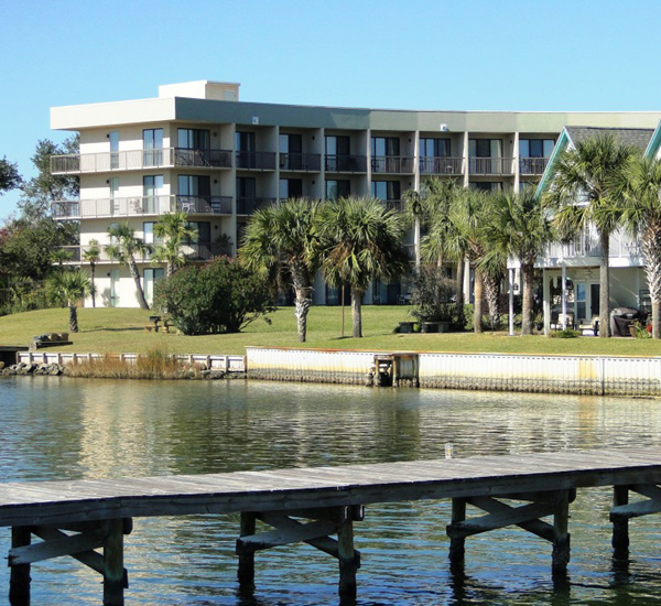 Pirates' Bay Guest Chambers & Marina exterior view from the water in Fort Walton Florida