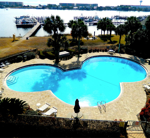 Landscaped pool with sundeck at Pirates' Bay Guest Chambers & Marina in Fort Walton Florida